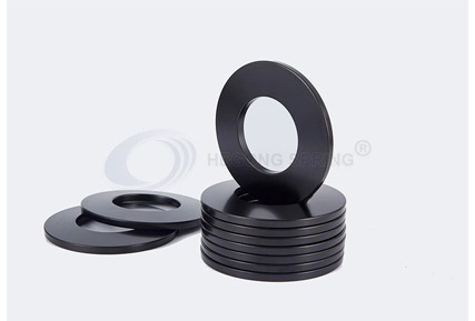What is the Applicable Temperature of the Disc Spring Material?
